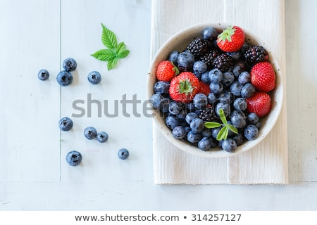 Fresh juicy strawberry in ceramic bowl and blueberry. Stock photo © X-etra