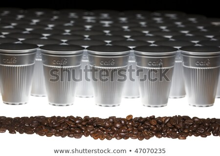 line of coffee beans in front of plastic cups stock photo © lichtmeister