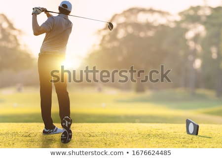 Golfer pitching at golf course. Stock photo © lichtmeister