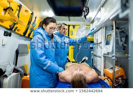 Paramédico doente homem colega Foto stock © pressmaster