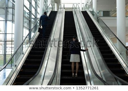 вид сзади бизнесмен деловая женщина движущихся эскалатор служба Сток-фото © wavebreak_media