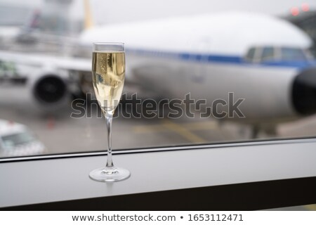 шампанского стекла посадка полет аэропорту самолет Сток-фото © AndreyPopov