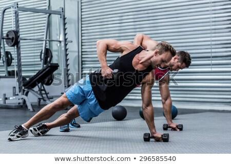 Obraz młodych silne człowiek wykonywania Zdjęcia stock © deandrobot