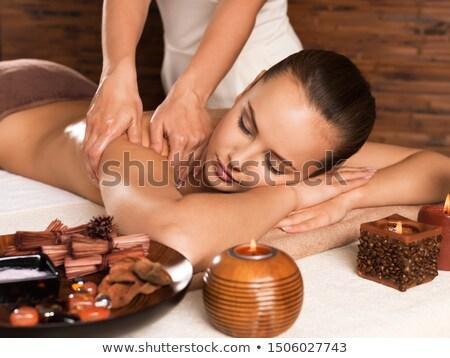 Profissional massagista massagem ombro mulher jovem estância termal Foto stock © boggy