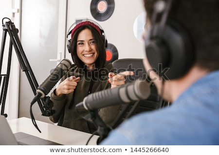 woman with microphone recording podcast at studio Stock photo © dolgachov