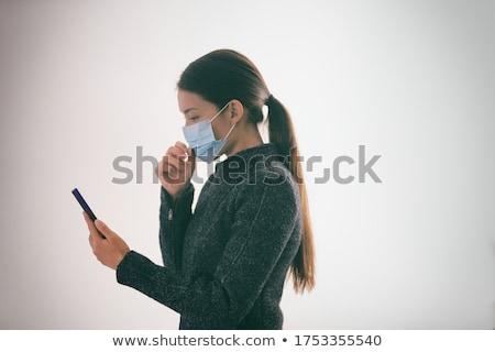 Masque femme toucher visage marche Photo stock © Maridav