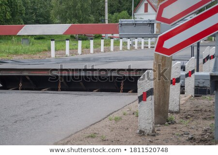 Red and white raised barrier stock photo © duoduo