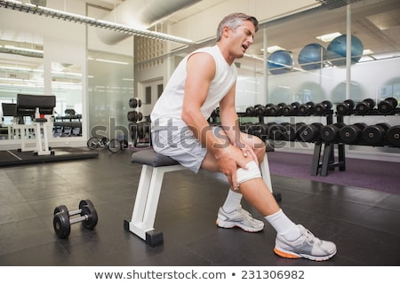 Man with injury wincing Stock photo © lovleah