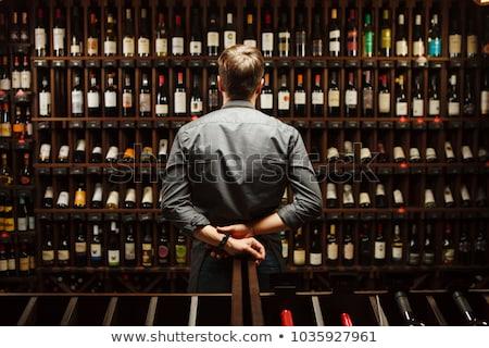Foto stock: Man In Wine Cellar