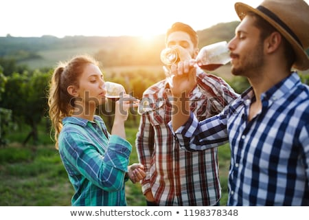 Stock photo: couple of wine-growers in vineyards