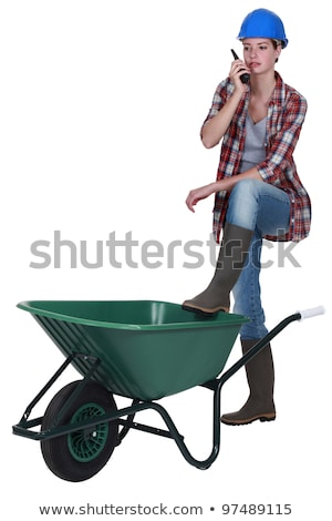 woman stood with empty wheelbarrow stock photo © photography33
