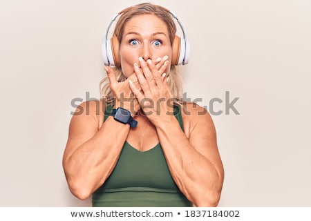 shy woman with headphones Stock photo © Rob_Stark
