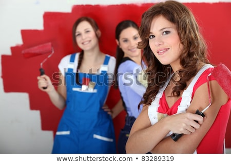 trio of handygirls painting room red Stock photo © photography33