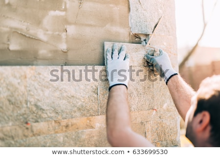 mosaic of mason working on site stock photo © photography33