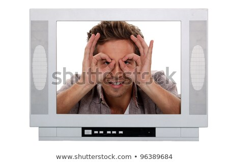 Man making a silly face inside a television frame Stock photo © photography33