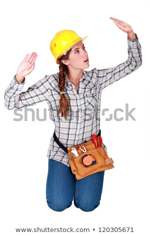 Tradeswoman patting invisible walls Stock photo © photography33