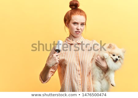 Angry woman with her hair in rollers Stock photo © photography33