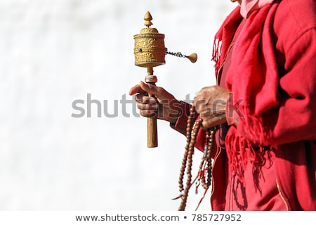Tibetan prayer wheel and beads on a white background Stock photo © bbbar