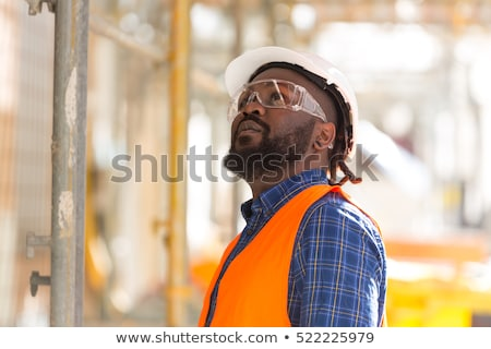 helmeted foreman looking upwards Stock photo © photography33