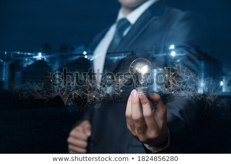 light bulb with burning tree inside in hand stock photo © vlad_star