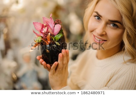 lovely blond with orchid stock photo © dolgachov