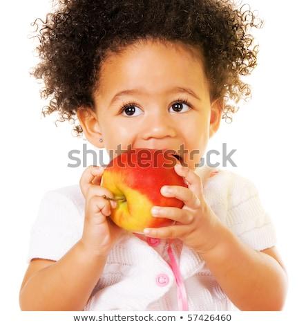 child girl loves to eat apple Stock photo © OleksandrO