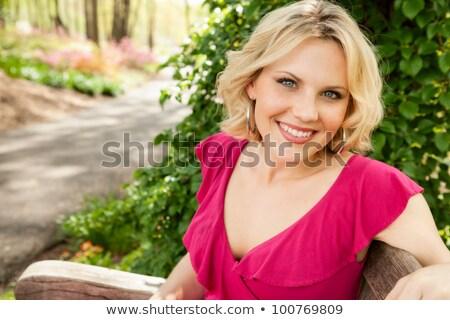 Güzel kadın oturma bahçe bank Stok fotoğraf © alexandrenunes