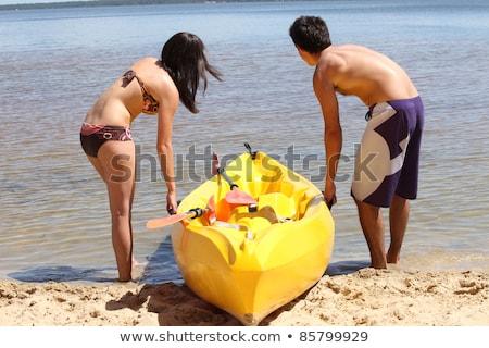 Couple dragging kayak onto lake Stock photo © photography33