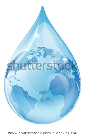 earth inside water drop stock photo © harlekino