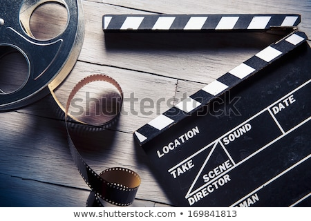 clapboard and film reel with film stock photo © tashatuvango