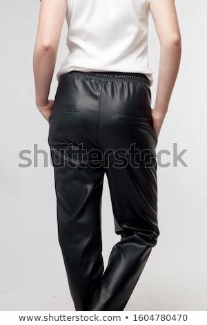 gyönyörű · fiatal · nő · fekete · bőr · nadrág · izolált - stock fotó © acidgrey