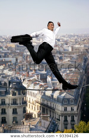 Stock photo: Businessman confidently walking across tight rope
