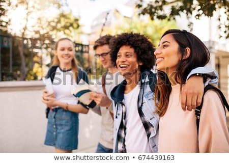 happy four teenage friends walking stock photo © rosipro