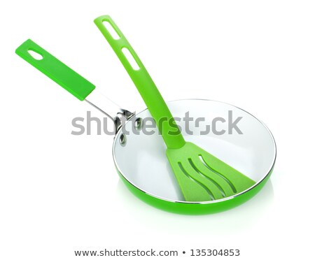 Stock photo: Green colored frying pan and utensil