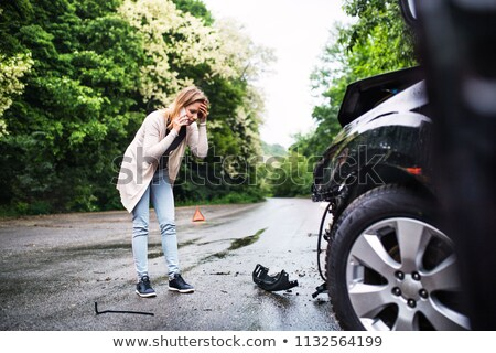 woman with damaged car calling for help  Stock photo © Nobilior