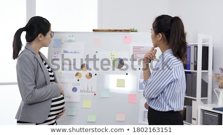 business woman thinking pregnancy plans stock photo © hasloo