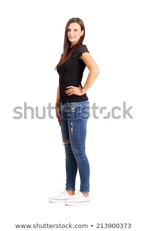 confident indian young woman standing with arms akimbo stock photo © bmonteny