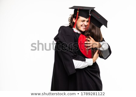 Happy graduated young students couple hugging  Stock photo © Nejron