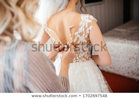 mother tying the brides wedding dress stock photo © aetb
