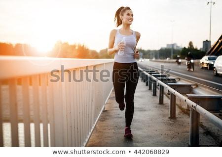 Jogging lány öröm teljes alakos portré izolált Stock fotó © elwynn