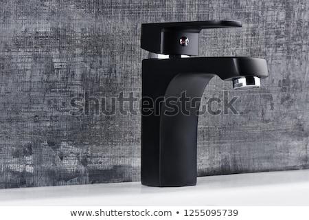 Fürdőszoba csap közelkép króm acél folyadék Stock fotó © ctacik
