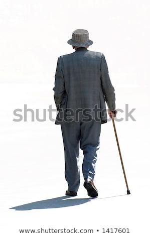 Nyugdíjas férfi sétál messze piros póló Stock fotó © ivonnewierink