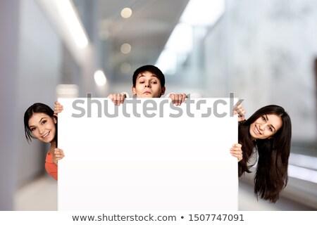 Teen girl holding blank sign. Stock photo © iofoto