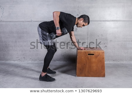 Oldalnézet fitt férfi testmozgás súlyzó fiatalember Stock fotó © wavebreak_media