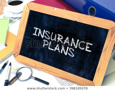 insurance plans on ring binder blured toned image stock photo © tashatuvango