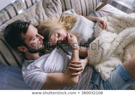 Aranyos pár ölelkezés kanapé otthon nappali Stock fotó © wavebreak_media