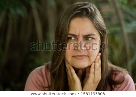 Desperate young woman touching her face. Concept of abuse and de Stock photo © nenetus