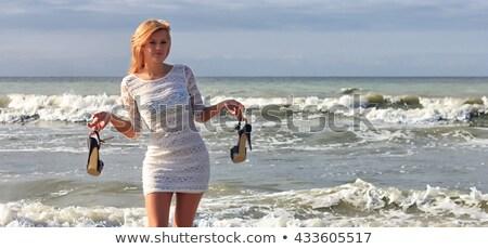 Blond tourist girl with flip flop shoes white dress Stock photo © lunamarina