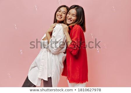 bonitinho · sorridente · menina · rosa · blusa · jeans - foto stock © elnur