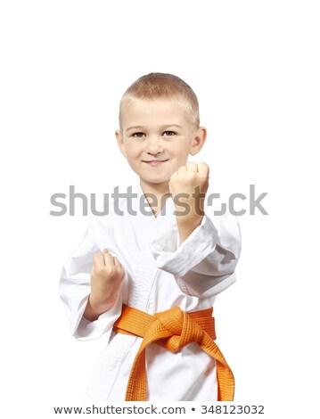 The child in karategi stay in rack karate Stock photo © Andreyfire